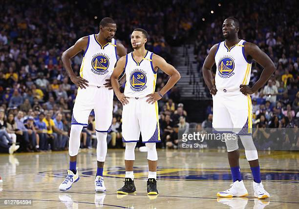 Kevin Durant Stephen Curry and Draymond Green of the Golden State Warriors stand on the court during their game against the Los Angeles Clippers...