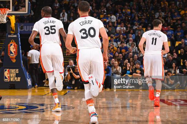 Kevin Durant Stephen Curry and Klay Thompson of the Golden State Warriors run up court during the game against the Los Angeles Clippers on January 28...