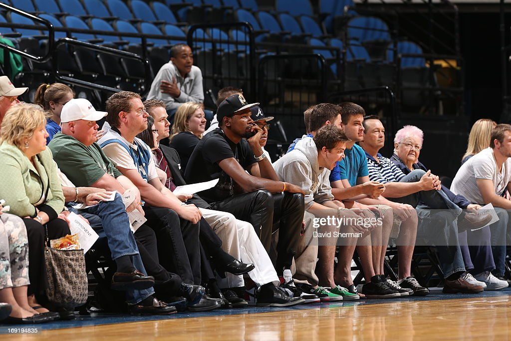 Kevin Durant watches during the WNBA pre-season game between the Minnesota Lynx and the Connecticut Sun on May 21, 2013 at Target Center in Minneapolis, Minnesota.