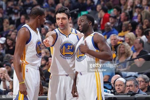 Kevin Durant Zaza Pachulia and Draymond Green of the Golden State Warriors talk during the game against the Sacramento Kings on January 8 2017 at...