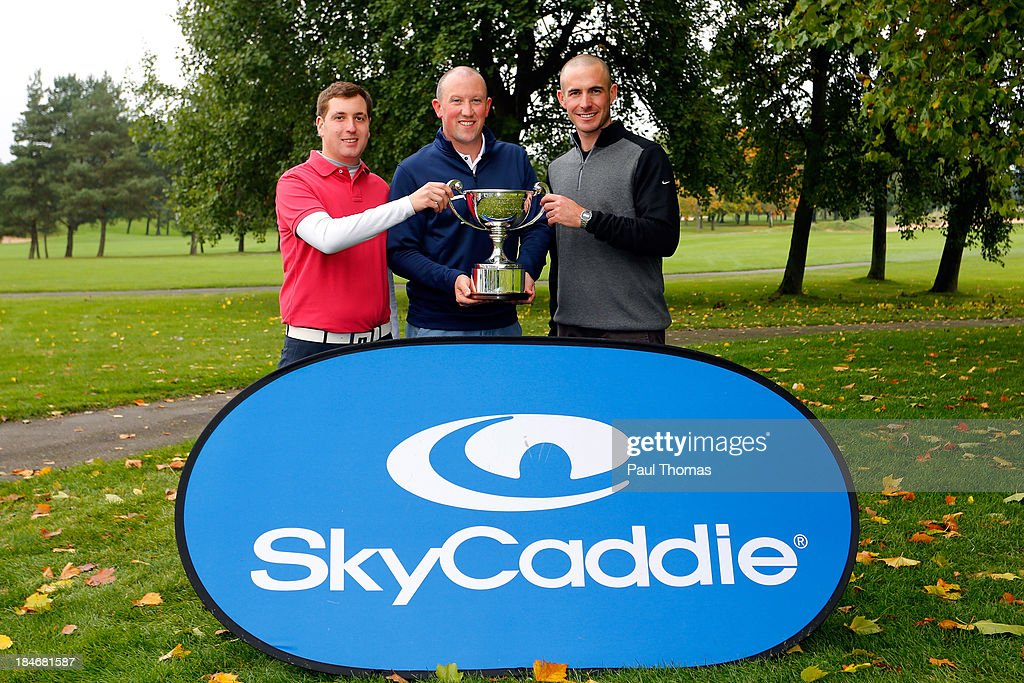 Kevin Earp (C) and Lawrence Dodd (R) of Bury Golf Range and Peter Latimer of Felixstowe Ferry Golf Club, representing Suffolk, pose with the trophy after winning the PGA England & Wales Inter County Championship at the Belfry Golf Course on October 15, 2013 in Sutton Coldfield, England.