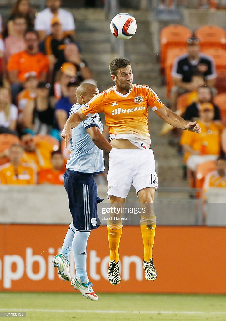 Kevin Ellis #4 of Sporting KC battles for the ball with Will Bruin #12 of Houston Dynamo during their game at BBVA Compass Stadium on April 25, 2015 in Houston, Texas.