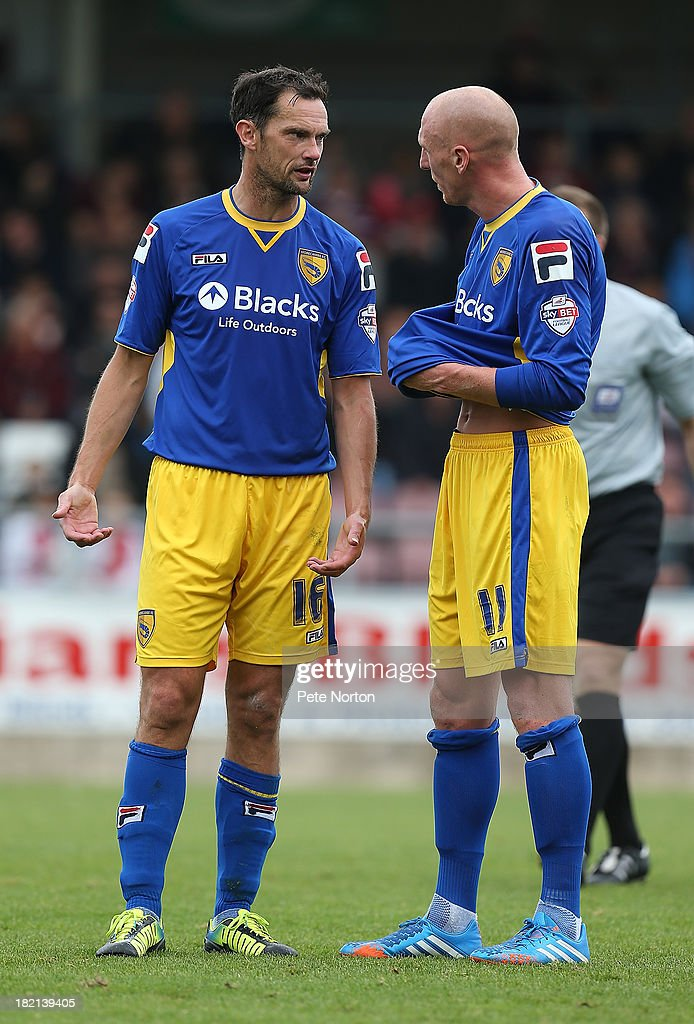 Kevin Ellison (r) and Stuart Drummond of Morecambe talk during the Sky Bet League Two match between Northampton Town and Morecambe at Sixfields Stadium on September 28, 2013 in Northampton, England.