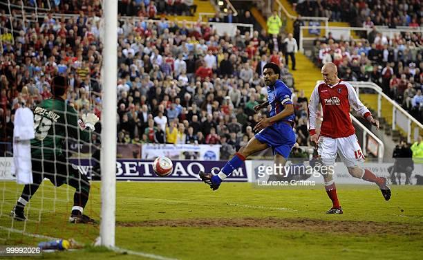 Kevin Ellison of Rotheram scores the second goal past Mikhael JaimezRuiz of Aldershot Town during the CocaCola League Two Playoff Semi Final 2nd Leg...