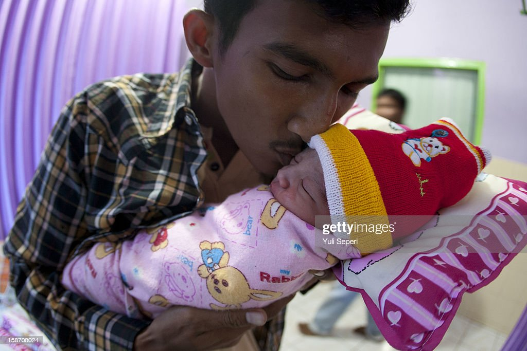 Kevin, father of new born Nicholas Kevin Stevanus (R), who was born at 9:30 am local time, kissed his baby after being born on Christmas day at Tanjungpinang Hospital on December 25, 2012 in Batam Island, Indonesia. Christmas is a national holiday in Indonesia despite only eight percent of the population identifying as Christian. Muslims in Indonesia celebrate the birth of Jesus and Hindu's in the country also commemorate the date.
