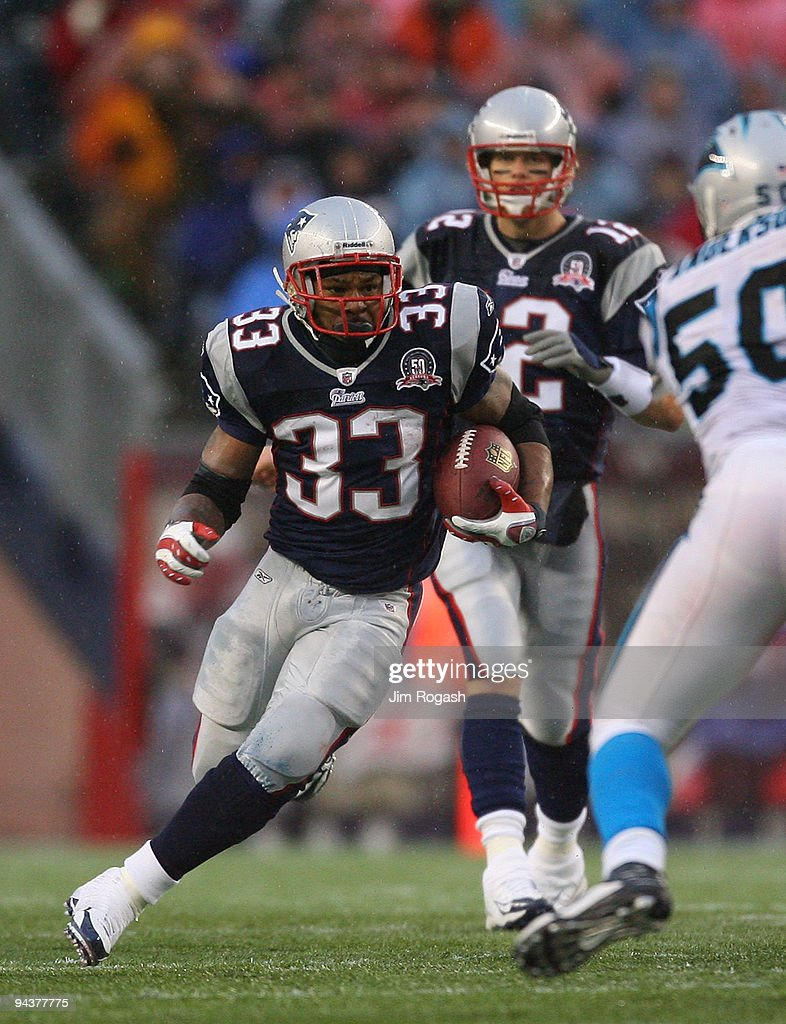 Kevin Faulk #33 of the New England Patriots gains yardage against the Carolina Panthers at Gillette Stadium on December 13, 2009 in Foxboro, Massachusetts. The Patriots won 20-10.