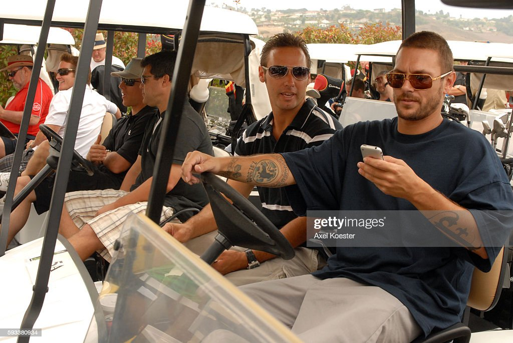 Kevin Federline and his brother Chris Federline wait in their golf cart at the X Games Celebrity Skins Classic golf tournament for charity at Trump...