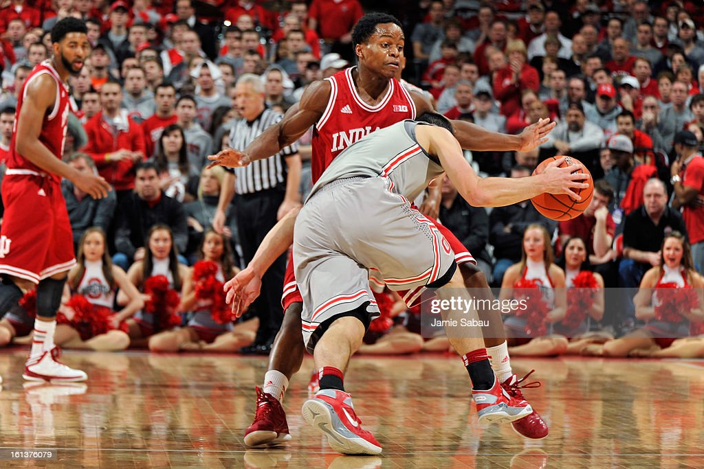 Kevin Ferrell #11 of the Indiana Hoosiers blocks <a gi-track='captionPersonalityLinkClicked' href=/galleries/search?phrase=Aaron+Craft&family=editorial&specificpeople=7348782 ng-click='$event.stopPropagation()'>Aaron Craft</a> #4 of the Ohio State Buckeyes in the first half on February 10, 2013 at Value City Arena in Columbus, Ohio. Indiana defeated Ohio State 81-68.