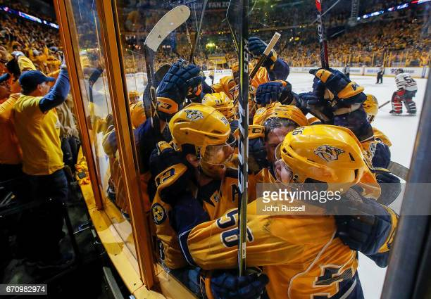 Kevin Fiala celebrates his game winner overtime goal with James Neal and the rest of the Nashville Predators against the Chicago Blackhawks in Game...