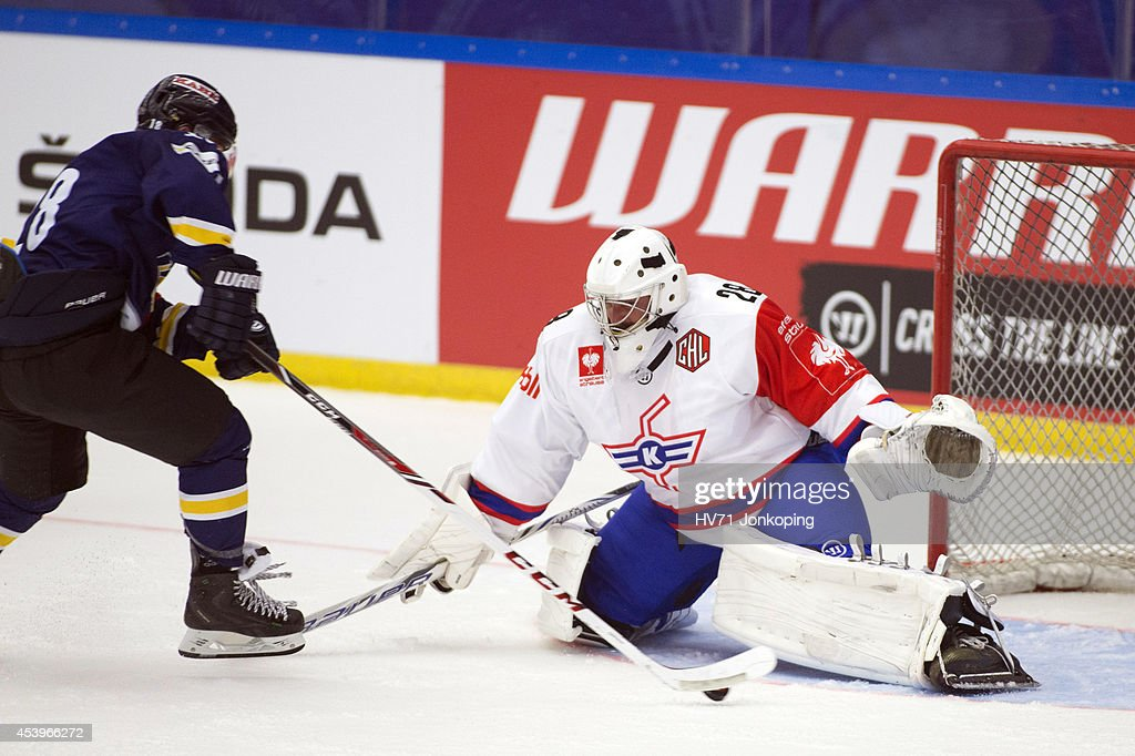 Kevin Fiala #18 of HV71 attempts a wraparound on Martin Gerber #28 ...