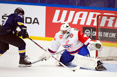 Kevin Fiala of HV71 attempts a wraparound on Martin Gerber Goaltender of Kloten Flyers during the Champions Hockey League group stage game between...