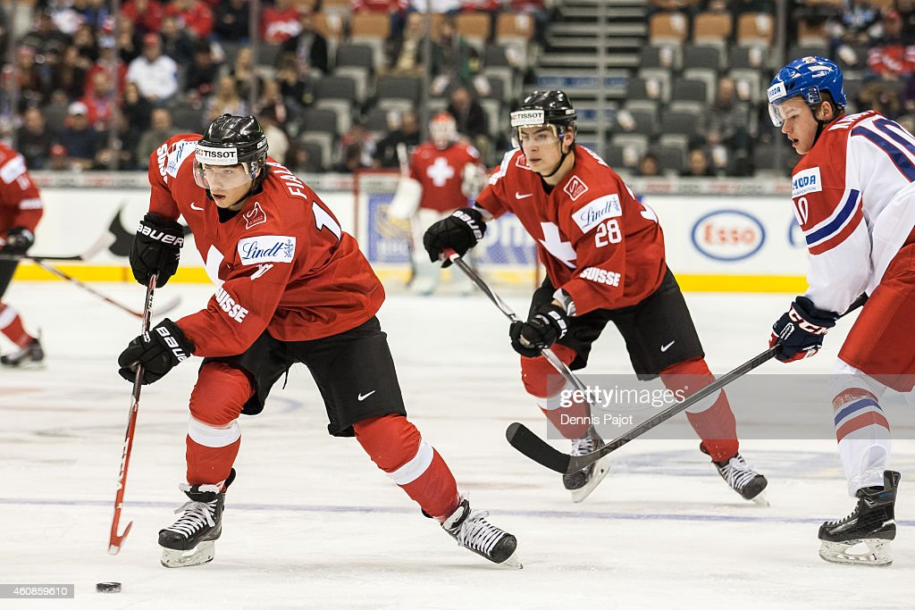 Kevin Fiala #10 of Switzerland moves the puck against Czech Republic during the 2015 IIHF World Junior Championship on December 27, 2014 at the Air Canada Centre in Toronto, Ontario, Canada.