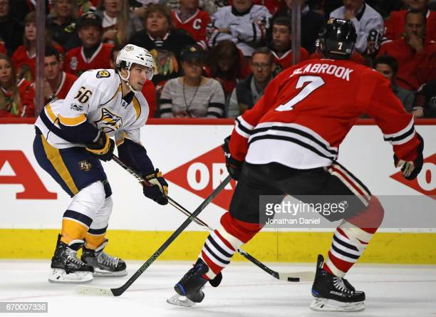 Kevin Fiala of the Nashville Predators advances against Brent Seabrook of the Chicago Blackhawks in Game One of the Western Conference First Round...