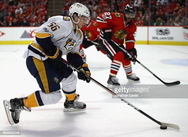 Kevin Fiala of the Nashville Predators advances the puck against Johnny Oduya of the Chicago Blackhawks in Game Two of the Western Conference First...