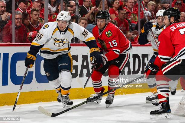 Kevin Fiala of the Nashville Predators and Artem Anisimov of the Chicago Blackhawks skate by the boards in the first period in Game Two of the...