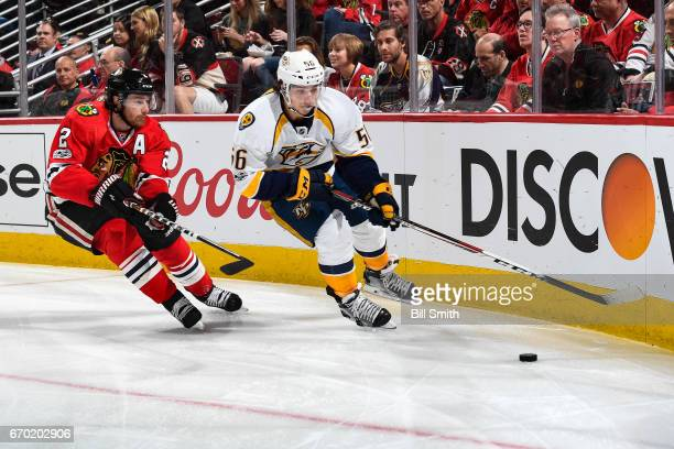 Kevin Fiala of the Nashville Predators and Duncan Keith of the Chicago Blackhawks chase the puck in the second period in Game Two of the Western...