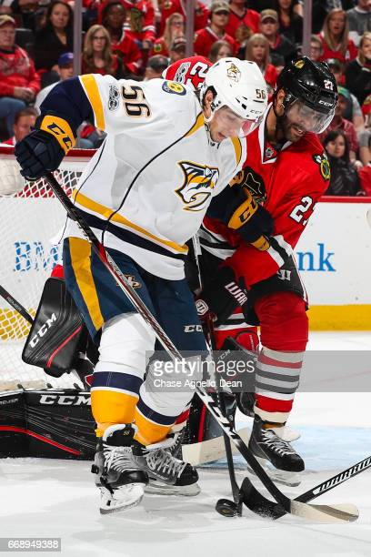 Kevin Fiala of the Nashville Predators and Johnny Oduya of the Chicago Blackhawks work to get the puck in the first period in Game Two of the Western...