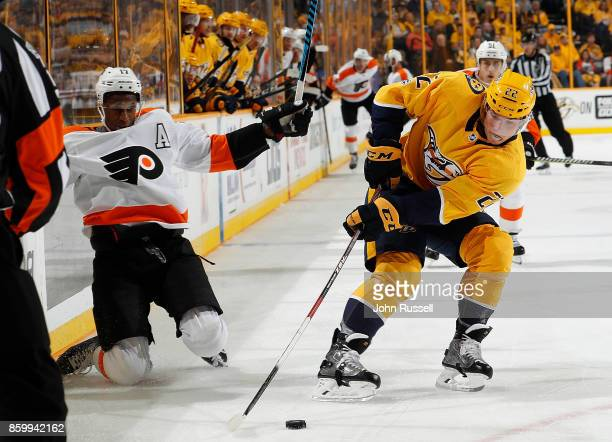 Kevin Fiala of the Nashville Predators battles for the puck against Wayne Simmonds of the Philadelphia Flyers during an NHL game at Bridgestone Arena...