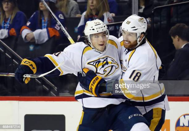Kevin Fiala of the Nashville Predators celebrates his goal at 1056 of the first period against the New York Islanders and is joined by James Neal at...