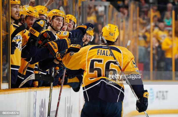 Kevin Fiala of the Nashville Predators celebrates his goal with the bench against the Minnesota Wild during an NHL game at Bridgestone Arena on April...