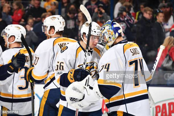 Kevin Fiala of the Nashville Predators celebrates with goaltender Juuse Saros of the Nashville Predators after defeating the Columbus Blue Jackets 43...