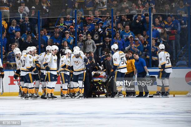 Kevin Fiala of the Nashville Predators is taken off the ice on a stretcher after getting hurt during a game against the St Louis Blues in Game One of...