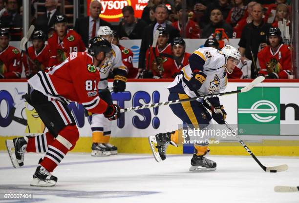 Kevin Fiala of the Nashville Predators moves past Marian Hossa of the Chicago Blackhawks in Game One of the Western Conference First Round during the...