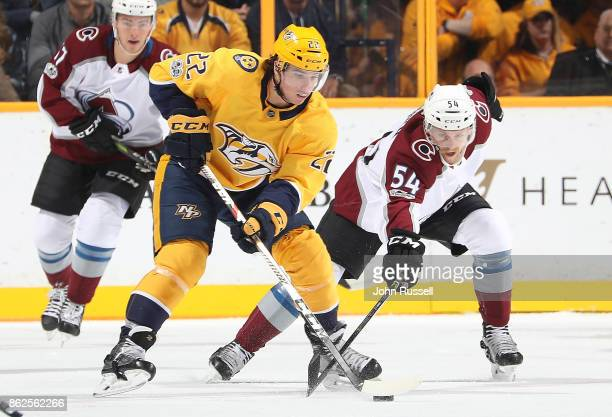 Kevin Fiala of the Nashville Predators skates against Anton Lindholm of the Colorado Avalanche during an NHL game at Bridgestone Arena on October 17...