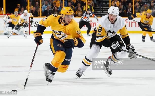 Kevin Fiala of the Nashville Predators skates against Brian Dumoulin of the Pittsburgh Penguins during an NHL game at Bridgestone Arena on November...