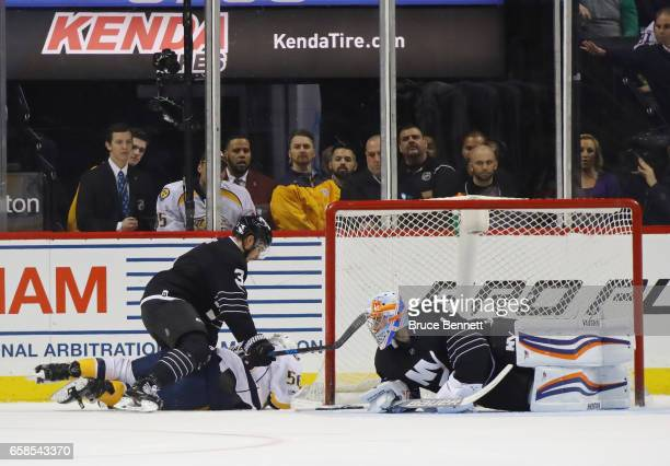 Kevin Fiala of the Nashville Predators skates into Thomas Greiss of the New York Islanders and is hit by Travis Hamonic during the second period at...