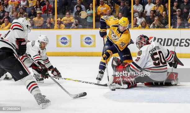 Kevin Fiala of the Nashville Predators skates the puck into the crease against Corey Crawford of the Chicago Blackhawks in Game Four of the Western...