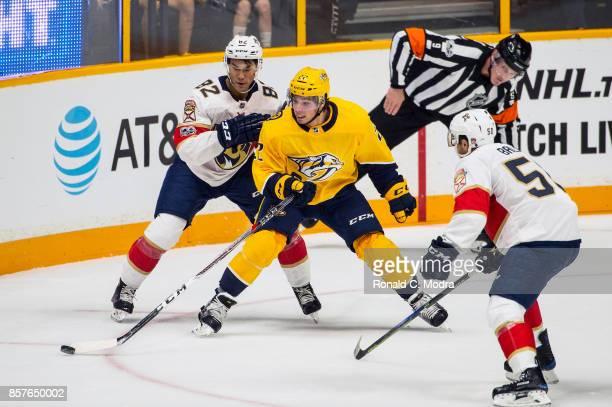 Kevin Fiala of the Nashville Predators skates with the puck as Jonathan Ang of the Florida Panthers chases during a NHL preseason game at Bridgestone...