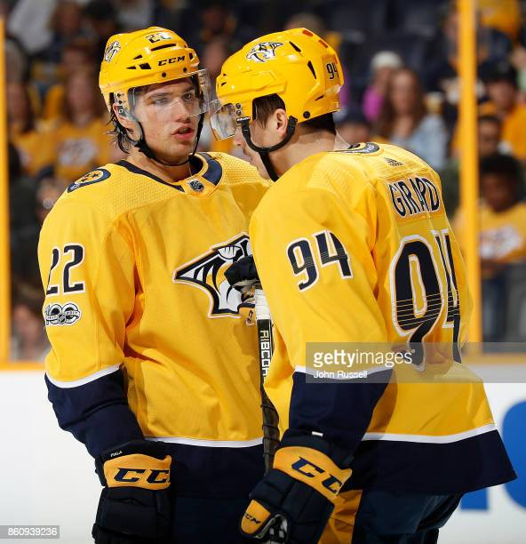 Kevin Fiala talks with Samuel Girard of the Nashville Predators after a whistle stop against the Philadelphia Flyers during an NHL game at...