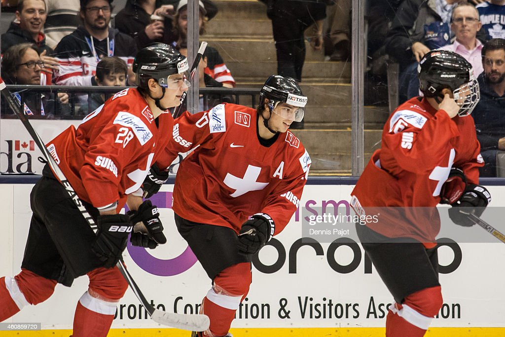 Kevin Fiala #10; Timo Meier #28 and Denis Malgin #16 of Switzerland celebrate a goal against Czech Republic during the 2015 IIHF World Junior Championship on December 27, 2014 at the Air Canada Centre in Toronto, Ontario, Canada.