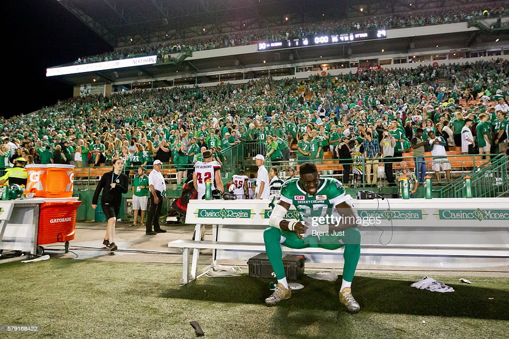 Kevin Francis #27 of the Saskatchewan Roughriders shows some emotion on the bench after the Roughriders win their first game of the season against the Ottawa Redblacks at Mosaic Stadium on July 22, 2016 in Regina, Canada.