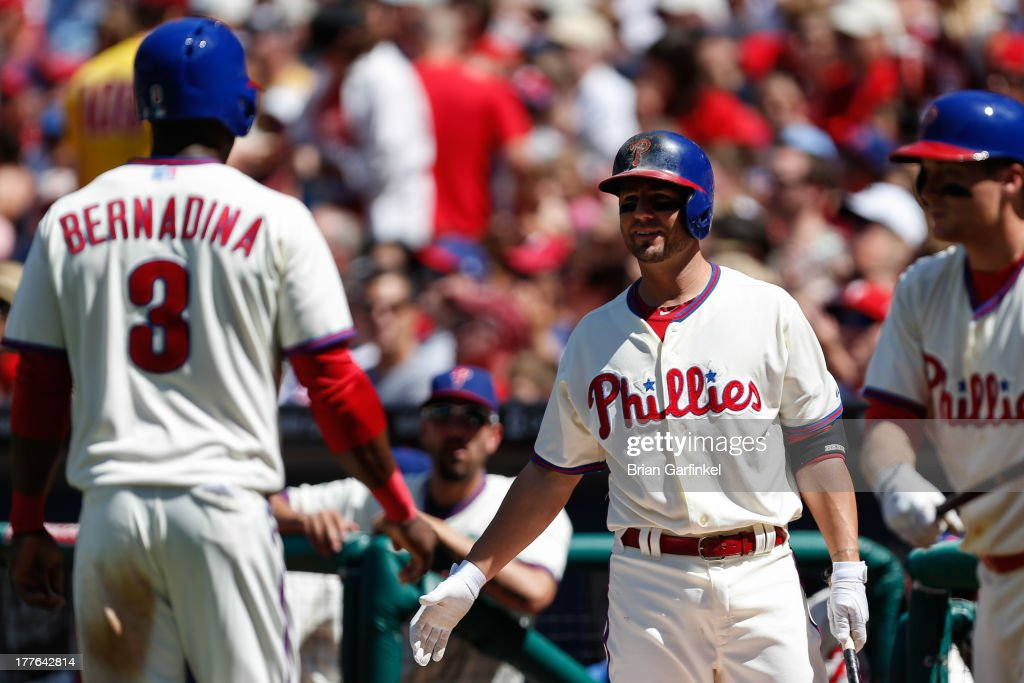 <a gi-track='captionPersonalityLinkClicked' href=/galleries/search?phrase=Kevin+Frandsen&family=editorial&specificpeople=3982842 ng-click='$event.stopPropagation()'>Kevin Frandsen</a> #28 of the Philadelphia Phillies congratulates <a gi-track='captionPersonalityLinkClicked' href=/galleries/search?phrase=Roger+Bernadina&family=editorial&specificpeople=4246414 ng-click='$event.stopPropagation()'>Roger Bernadina</a> #3 after Bernadina scored a run in the first inning of the game against the Arizona Diamondbacks at Citizens Bank Park on August 25, 2013 in Philadelphia, Pennsylvania.