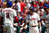Kevin Frandsen of the Philadelphia Phillies congratulates Roger Bernadina after Bernadina scored a run in the first inning of the game against the...