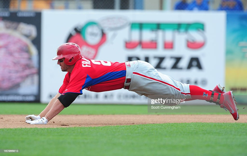 Kevin Frandsen #28 of the Philadelphia Phillies dives in to second base for a double during a spring training game against the Toronto Blue Jays at Florida Auto Exchange Stadium on March 2, 2013 in Dunedin, Florida.