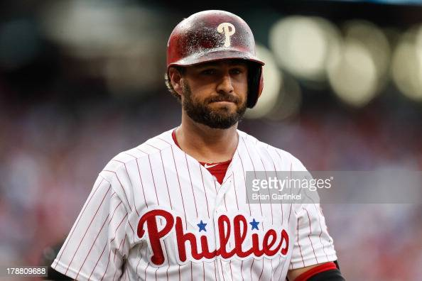 Kevin Frandsen of the Philadelphia Phillies looks on as he walks back to the dugout after an at bat during the game against the Washington Nationals...