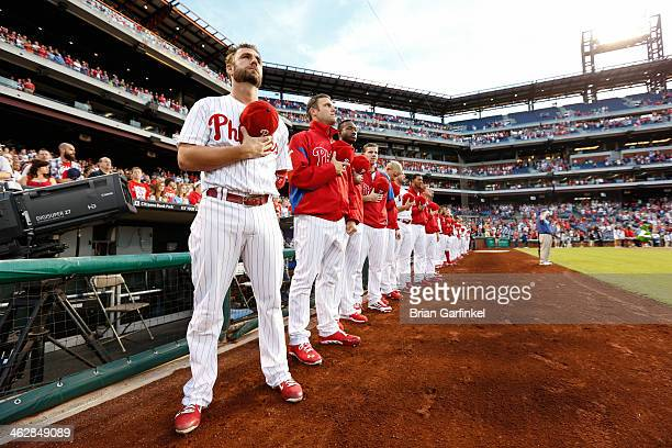 Kevin Frandsen of the Philadelphia Phillies looks on during the singing of the National Anthem before the game against the Atlanta Braves at Citizens...