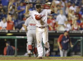 Kevin Frandsen of the Philadelphia Phillies reacts after striking out to end the eighth inning against the Washington Nationals at Citizens Bank Park...