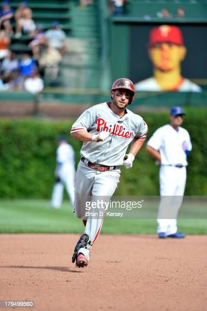 Kevin Frandsen of the Philadelphia Phillies rounds the bases after hitting a solo home run during the seventh inning against the Chicago Cubs at...