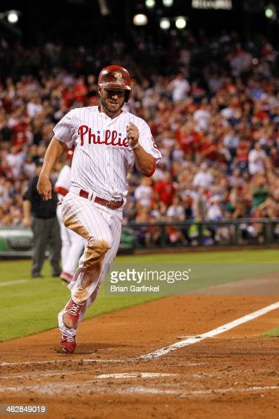 Kevin Frandsen of the Philadelphia Phillies scores a run during the game against the Atlanta Braves at Citizens Bank Park on September 7 2013 in...