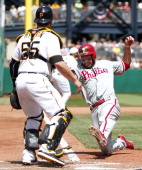 Kevin Frandsen of the Philadelphia Phillies scores on a fielder's choice in the sixth inning against the Pittsburgh Pirates during the game on July 4...
