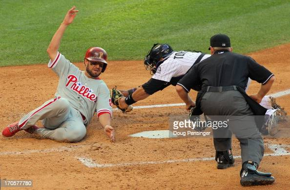 Kevin Frandsen of the Philadelphia Phillies slides home to score on a double by John Mayberry Jr #15 of the Philadelphia Phillies around the tag of...
