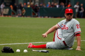 Kevin Frandsen of the Philadelphia Phillies stretches out while on the field prior to the start of the game against the San Francisco Giants at ATT...