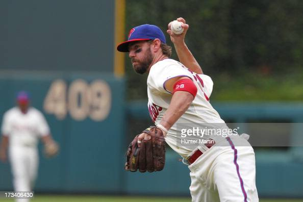 Kevin Frandsen of the Philadelphia Phillies throws to first base during a game against the Chicago White Sox at Citizens Bank Park on July 13 2013 in...