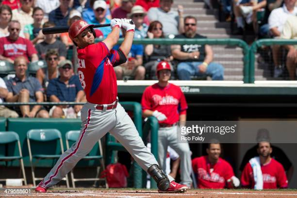 Kevin Frandsen of the Philadelphia Phillies watches the ball during the game against the Atlanta Braves at Champion Stadium on March 11 2014 in Lake...