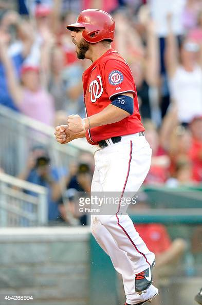 Kevin Frandsen of the Washington Nationals celebrates after scoring in the seventh inning against the Pittsburgh Pirates at Nationals Park on August...