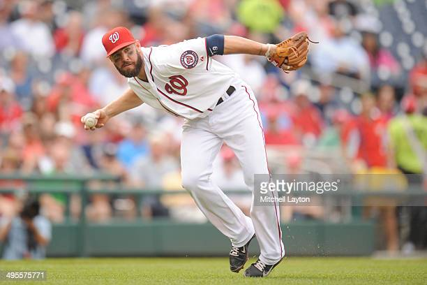 Kevin Frandsen of the Washington Nationals fields a ground ball during a baseball game against the Cincinnati Reds on May 21 2014 at Nationals Park...